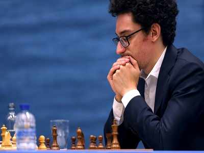Fabiano Caruana joins Magnus Carlsen at the top on a day of two Armageddons