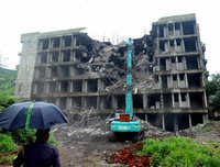 Building on the verge of collapse demolished near Mumbai