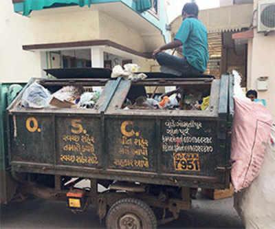 Gandhinagar residents raise stink over trash vans