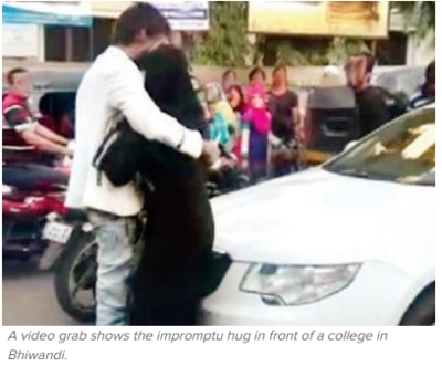 Couple forced to apologise as video of hug goes viral