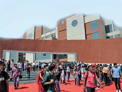 Staring at vacant seats, colleges eye 'outsiders'