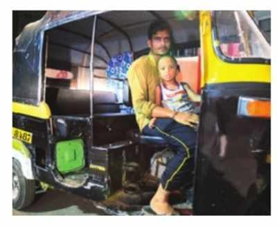 Paralysed wife at home, auto driver plies around with 2-yr-old son in lap