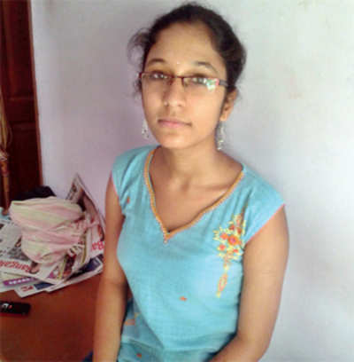A girl who makes lamp wicks scores 98.5% in SSLC