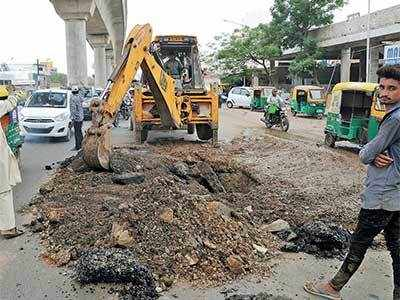 Just-resurfaced road dug up, AMC depts pass the buck