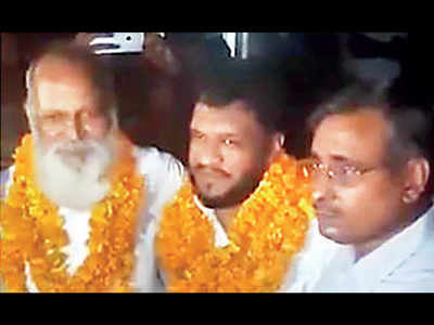 UP government plays down grand welcome