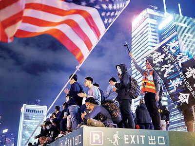 Trump signs HK bills, China warns of action