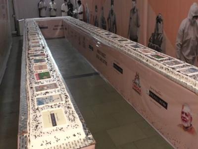 On PM Modi's birthday, Surat bakery makes 71-feet-long cake with 'corona warriors' theme