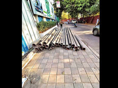 Pipes block space on Bibwewadi pavement