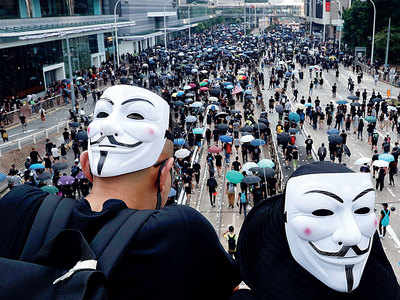 Hong Kong banning face masks to tackle disguised protesters