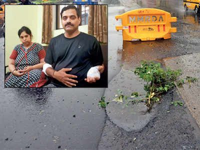 Mumbai rains: Motorbike-bound couple hit a perilous pothole