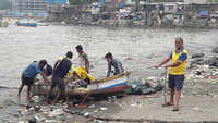 Fishermen in Mumbai's Badhwar Park pulled their boats out of the water as Cyclone Tauktae approaches