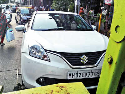 After 6-month gap, cops start to tow cars again