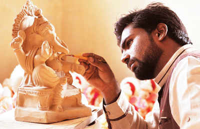 Engineer chisels Ganpati statues from riverbeds