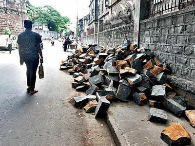 Debris eats up footpath in Budhwar Peth