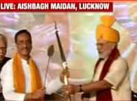 PM Modi felicitated with bow-arrow and mace at Dussehra rally in Lucknow
