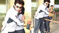 Female fan hugs Karthik Aryan at the airport