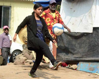 Footballer feted by Modi strives to leave footpath