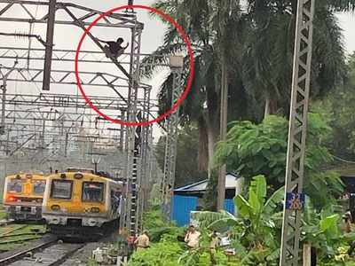 Man climbs overhead wire mast near Thane; local train services affected