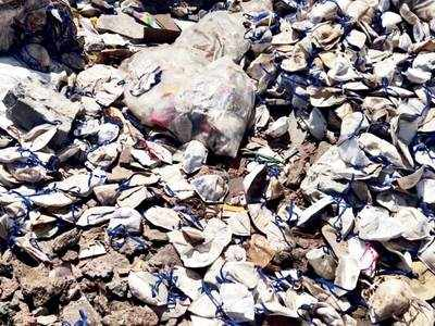 1 lakh masks dumped in Bhiwandi; team of officials inspect the spot near water pipeline