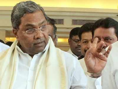 Siddaramaiah loses cool, pulls microphone during wordy duel with woman party worker