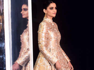 Sonam Kapoor looks royal in a gold outfit at a recent event