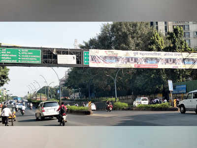 PMC's hoarding covers Ganeshkhind Rd signage
