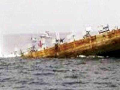 Salt-laden barge sinks, Coast Guard saves six