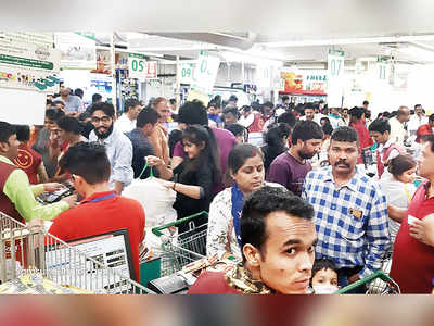 Panic in city amid partial lockdown: Govt shuts down theatres, gyms, swimming pools; citizens throng stores to stock up on essentials