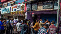 Though only online services have been restored for liquor, people thronged outside liquor shops, where some stores even started selling it to them off the counter