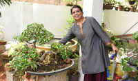 A botanist and her bonsai garden