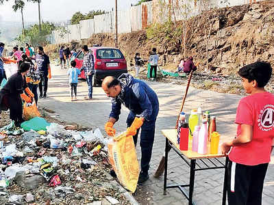 Kothrud residents clean garbage after PMC's alleged laxity