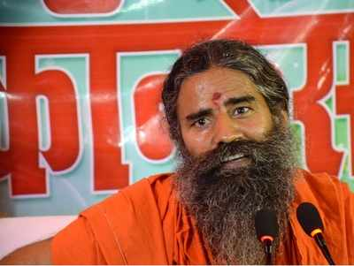 Days after Amul, Mother Dairy price hike, Baba Ramdev's Patanjali  launches toned milk, butter at lower prices