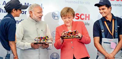 Wannabe techie rubs shoulders with Merkel, Modi; makes waves