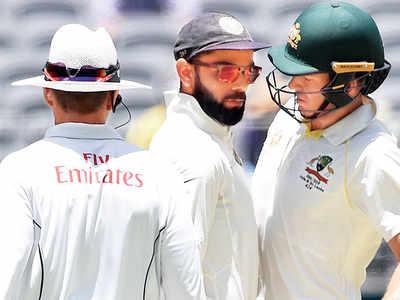 Virat Kohli, Tim Paine clash verbally; umpire intervenes