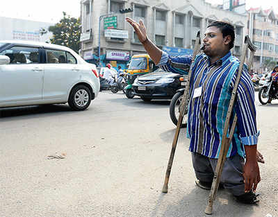 Polio-affected man is now a traffic warden