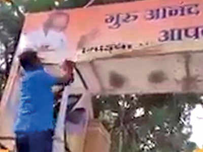 Louts tear down Hindi hoarding