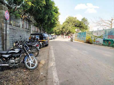 Illegal parking jams road in Shivajinagar