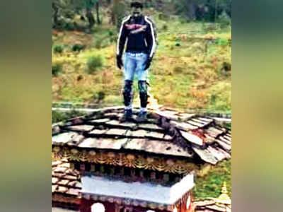 Indian biker climbs atop Bhutan stupa, detained