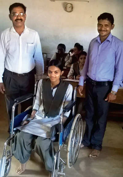 Girl on wheels gets 90 per cent in PU exam