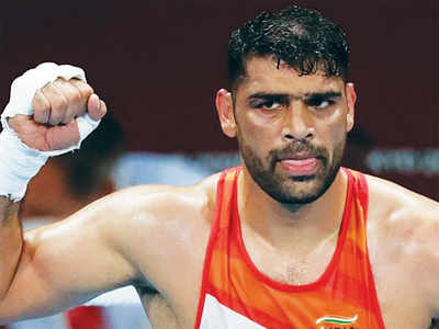 Boxer Satish Kumar enters quarters after defensive bout