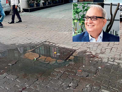 Market guru falls in open manhole, escapes death