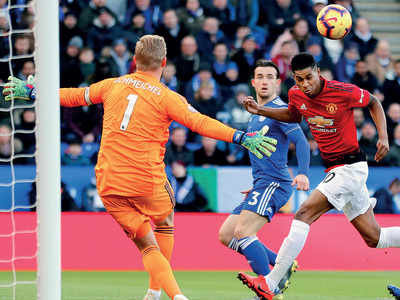 Marcus Rashford celebrates century as Manchester United march on