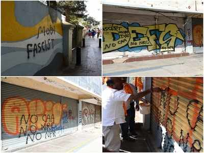 Graffiti against BJP, CAA, NRC appeared on Church Street walls; BJP supporters covered with saffron paint