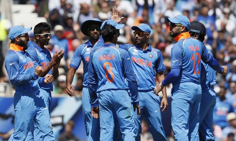 India cruise to semis, choking South Africa