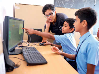 Two 15-year-olds are teaching basic computing skills to government school students