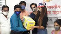 Poonam Pandey and husband Sam Bombay distribute ration kits to spot boys, technicians amid COVID-19 crisis