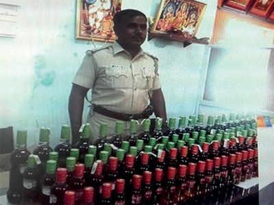 Liquor firm exec had 7 cases of vodka at home