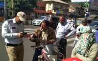 Pune: Traffic cops start implementing compulsory helmet drive in new year