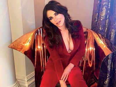 Liz Hurley 'bedazzles' fans in red hot jumpsuit