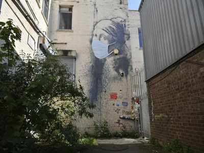 Banksy's 'Girl with a Pierced Eardrum' gains a COVID-19 face mask